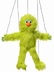 silly educational green monster marionette tall